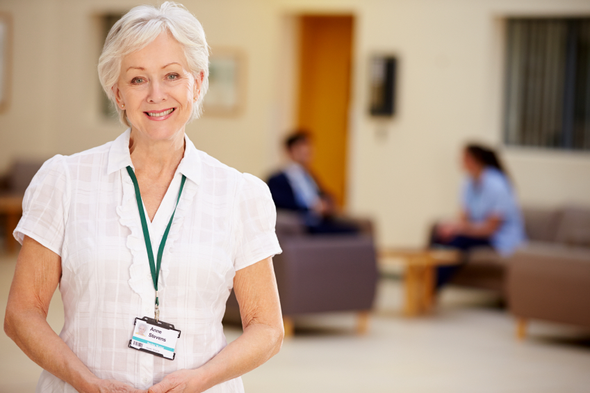Professionals in the medical reception field greet patients with care & administrative expertise.