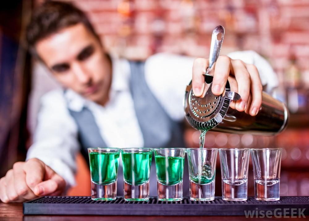bartender-pouring-shots-on-counter